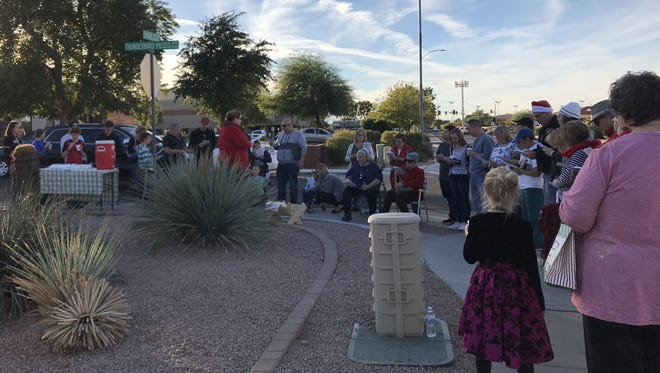 """Anti-abortion groups gather at the outside the Planned Parenthood facility at 5771 W. Eugie Ave. calling for """"Peace in the Womb"""" with Christmas carols on Dec. 9, 2017."""