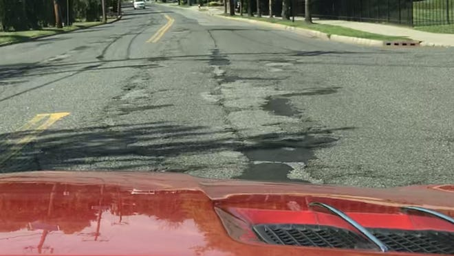 Nearly a mile of cracked asphalt through the windshield on Piermont Road in Tenafly.