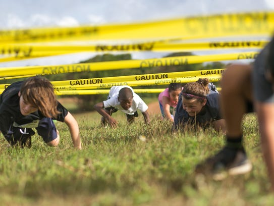 Kids crawl under caution tape as one of the 10 different