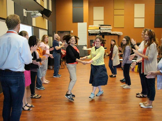 Students take part in folk dancing during a previous Kodály Summer Graduate Music Program at Silver Lake College of the Holy Family.