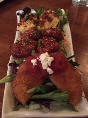 FIVE Bar is included in the East Tennessee Tours of downtown restaurants. Here customers enjoyed Southern cayenne candied bacon deiled eggs, uptown sweet and spicy shrimp and fried green tomatoes with tomato jam and goat cheese topping.