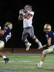 Tommy McGivney of Tappan Zee hauls in a reception during a varsity football game against Our Lady of Lourdes at Our Lady of Lourdes High School in Poughkeepsie Sept. 28, 2017.