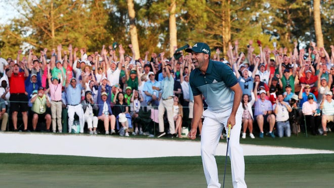 Sergio Garcia celebrates after defeating Justin Rose on the first playoff hole to claim his first major championship.