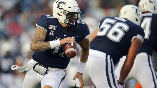 Connecticut quarterback Jack Zergiotis rolls out of the pocket during a Sept. 7 game against Illinois in East Hartford, Conn.