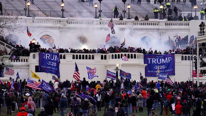 Violent protesters storm the Capitol on Jan. 6 in Washington. People charged in the attack left behind a trove of videos and messages that have helped federal authorities build cases.