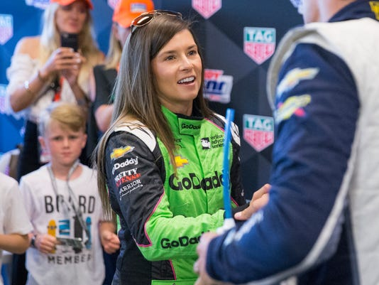 Danica Patrick shakes the hand of Max Chilton, during the 102nd running of the Indy 500 on lap 67, at Indianapolis Motor Speedway