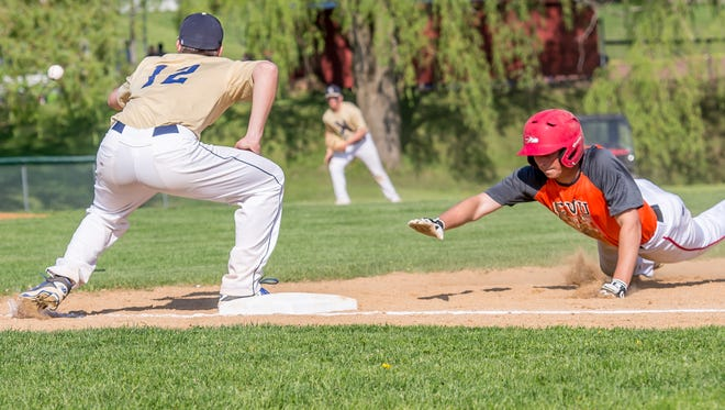 Essex's Garrett Somerset, left, looks to grab a pick-off attempt as a Champlain Valley runner retreats to first during Thursday's baseball game in Hinesburg.
