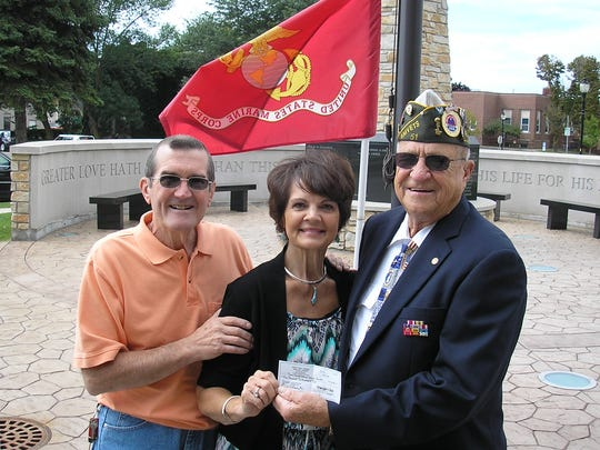 Scott and Phyllis Chobot donate $1,200 to Joe Heilman with the Door County Veterans Service Council.