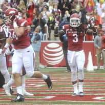 Arkansas' Alex Collins (3) celebrates after a touchdown against Mississippi State.