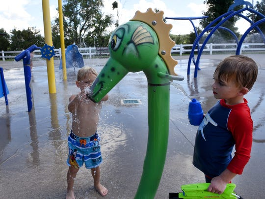Benjamin Duvall, right, 3, and Asher Millsaps, 3, playing in the splash pad at Carl Cowan Park  Tuesday, August 16, 2016. The temperature was 95-degrees with 42 percent humidity.  (MICHAEL PATRICK/NEWS SENTINEL)