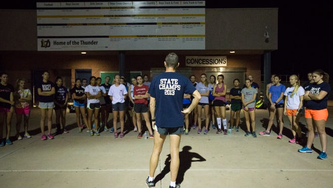 The Desert Vista girls cross country team, coached by Dr. Jeff Messer (back to camera), was as dominant as expected at the Division I girls cross country championship Saturday.