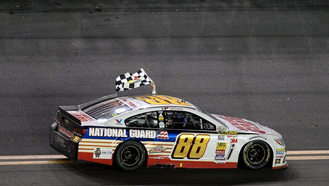 DAYTONA BEACH, FL - FEBRUARY 23:  Dale Earnhardt Jr., driver of the #88 National Guard Chevrolet, celebrates with the checkered flag after winning the NASCAR Sprint Cup Series Daytona 500 at Daytona International Speedway on February 23, 2014 in Daytona Beach, Florida.  (Photo by Jared C. Tilton/Getty Images)