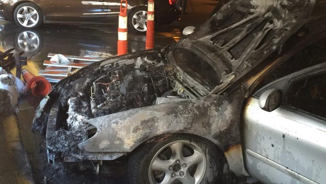 A car was left scorched after a fire in a Des Moines parking garage.