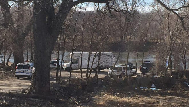 Authorities on the scene where a woman's body was found in the Des Moines River near the Harriet Street boat ramp.