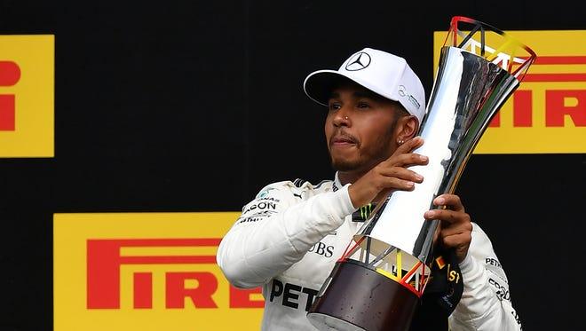 Lewis Hamilton celebrates on the podium.