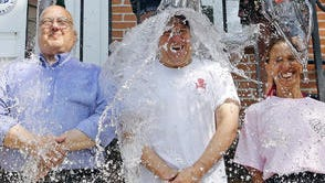 Town Supervisor Peter DiPaola, County Legislator Jim Maisano and Assemblywoman Amy Paulin get ice water dumped on them to raise awareness and funds for amyotrophic lateral sclerosis on July 25 outside Pelham Town Hall. Pelham resident Jeanette Senerchia, whose husband, Anthony Senerchia, suffers from ALS, started the ice bucket challenge to raise awareness about the disease.