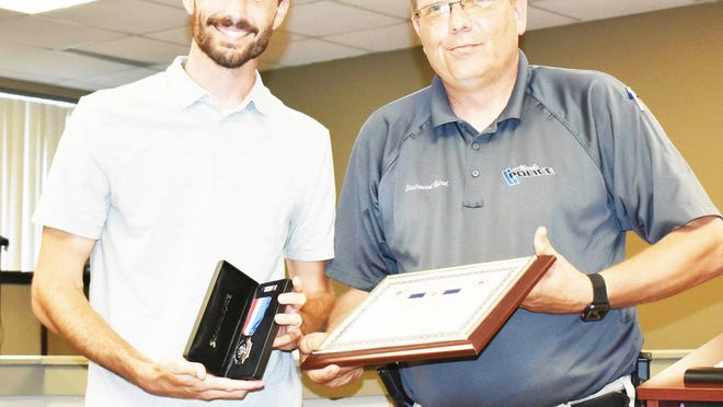 James Carter, Neosho, received a Life Saving Award from the city for his quick actions in saving a juvenile from flooded Hickory Creek in Morse Park during recent flooding.