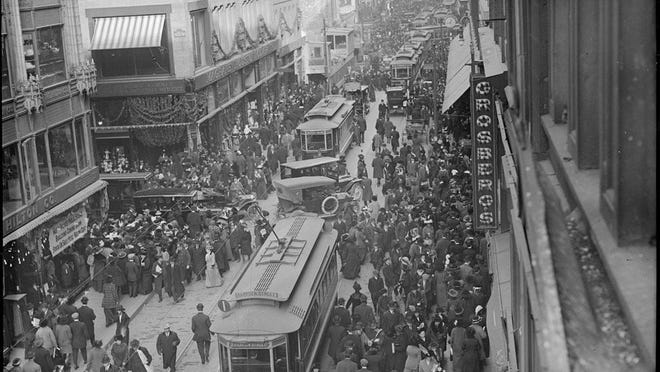 Shoppers crowd through Downtown Boston in 1912. Learn more from Digital Commonwealth at www.digitalcommonwealth.org.