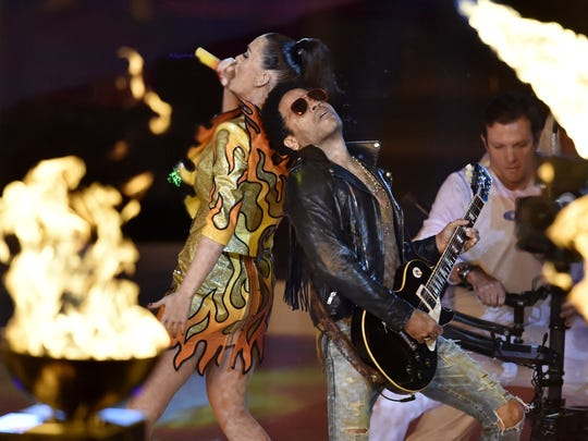 Katy Perry and Lenny Kravitz perform during halftime show on Sunday at University of Phoenix Stadium. Kravitz appeared in one song with Perry, who had dancing sharks with her on stage at one point.