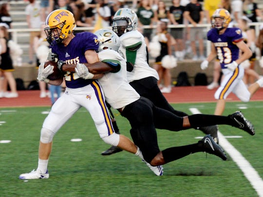 Calvary's Eric Reed Jr. tries to take down Byrd's Lawson