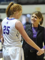 ACU coach Julie Goodenough, right, talks to Lexi Kirgan during a Dec. 16, 2017, game at Moody Coliseum.