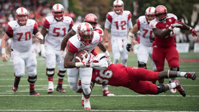 Western Kentucky wide receiver Nacarius Fant (1) is tackled by Miami of Ohio linebacker Paul Moses (36) during the first half of an NCAA college football game Saturday, Sept. 26, 2015, in Bowling Green, Ky. (AP Photo/Michael Noble Jr.)