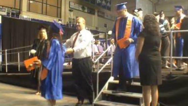 Cape Coral High School students graduate.