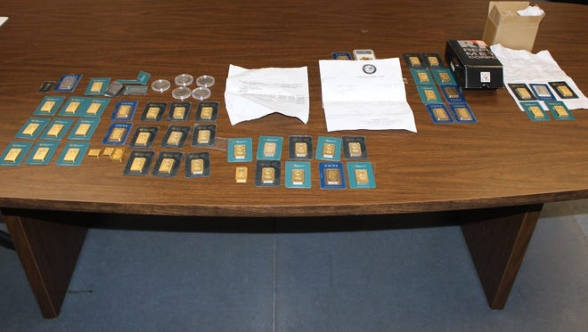 State police say these counterfit gold coins and bars were confiscated in a home last week.