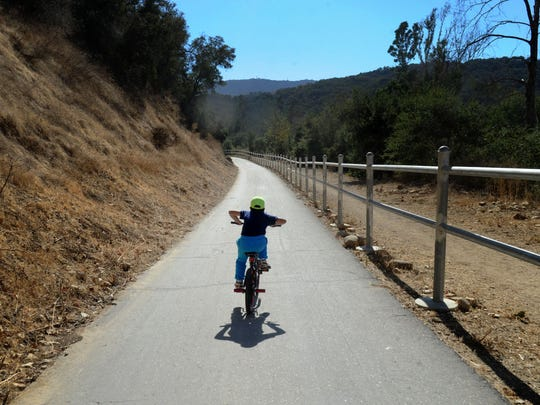 A bike rider explores the Ojai Valley Bike Trail.