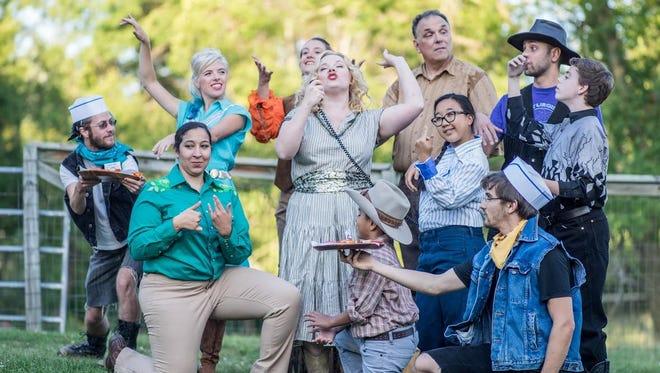 """Members of the """"Alcina's Island: A Picnic Operetta"""" ensemble surround Alcina (Carolyn Cavadini)."""