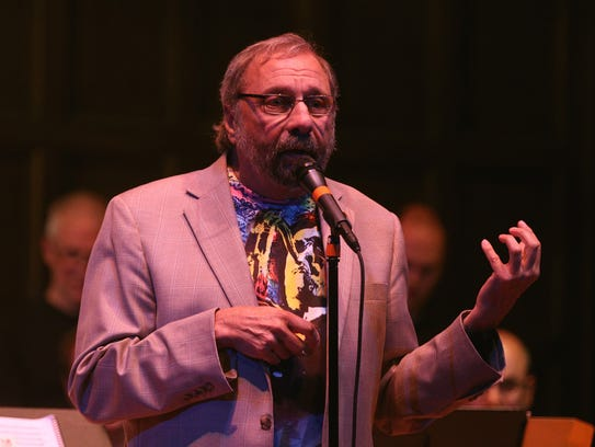 John LaBarbera tells a story to the audience as the