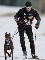 Mike Christman of Neenah trains in skijoring with his dog Ridge earlier this month in Neenah.