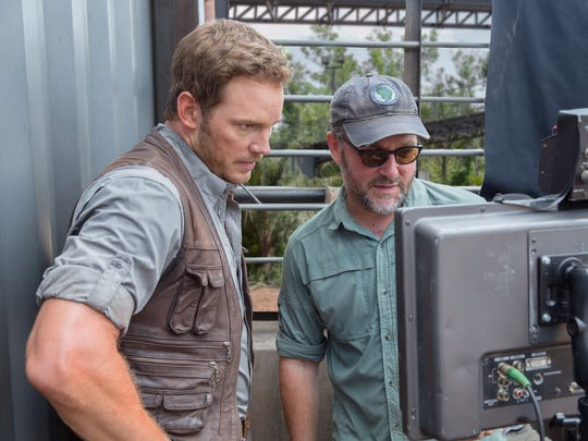 """Actor Chris Pratt and director Colin Trevorrow, right, on the set of """"Jurassic World."""""""