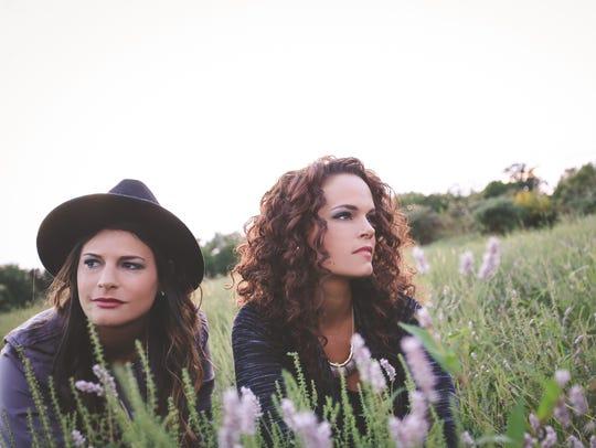 Twin sisters Kristen (left) and Kellie Fuselier of