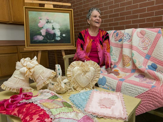 Eula Fern Thompson sits with creative items made by members of her family. The items pictured, clockwise from top are, a painting by her mother Hazel Hall McElyea, a quilt by her grandmother Ira Rodgers Hall, and needlework by her grandfather's third wife Josefina McElyea. The show will open with a reception from 5 to 7 p.m. Friday at St. Paul's United Methodist Church.