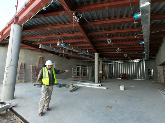 City of Las Cruces architect Tomas Mendez shows the location of the gym on the bottom floor of the new fire station / police station serving the East Mesa on Thursday.