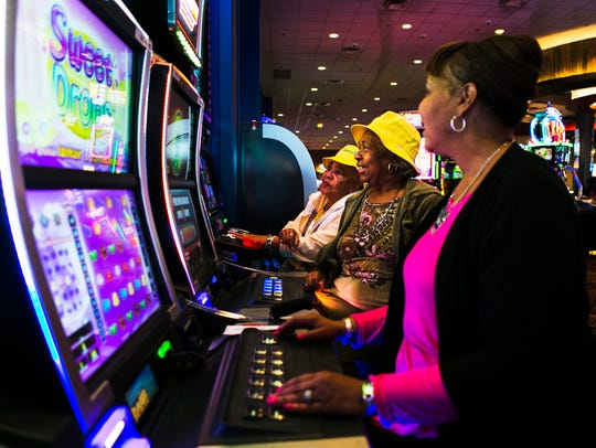 St. Louis tourists Sandy Buford (from left), Armentha Russell and Beverly Williams play electronic games at Southland Park Gaming and Racing in West Memphis.