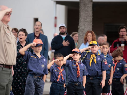 Boy Scouts recite the Pledge of Allegiance during the