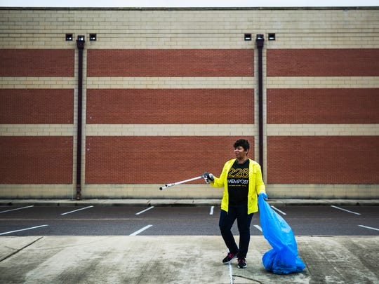 """Kiva Montgomery keeps a watchful eye on her 15-year-old daugher, Kyra Sims, as she stands outside Douglass High School on Ash St. during a Memphis Kings and Clean Memphis cleanup in the Douglass neighborhood on Saturday morning, Feb. 18, 2017. The organizations teamed up to shine a positive light on young African-American teens in Memphis. """"Everyday we get new opportunities to teach kids what community is about,"""" said Sam Davis, CEO and founder of Memphis Kings Youth Organization. """"I tell everybody I meet, you know, in order to change the world the only thing you got to do is change your world. Change the world you live in and you will be changing the world."""""""
