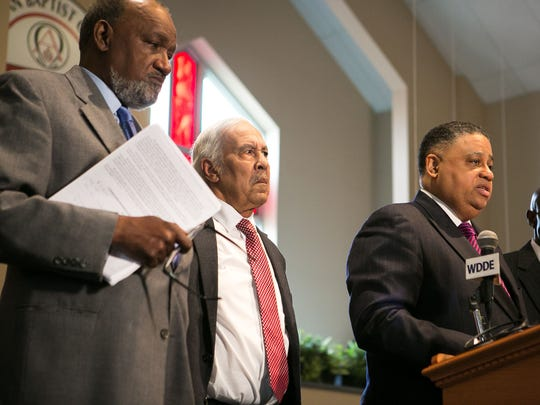 The Rev. Christopher Bullock (right) and the Delaware Coalition of Prison Reform and Justice release formal demands of Delaware's congressional delegation.