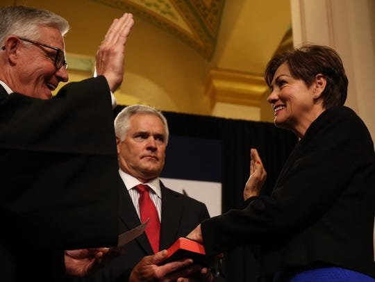 Kim Reynolds is sworn in Wednesday, May 24, as Iowa's first female governor. Beside her is her husband, Kevin Reynolds.