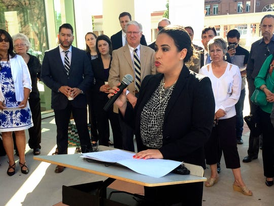 Marisa Bono, southwest regional counsel for the Mexican American Legal Defense and Educational Fund, outlines accusations that the state of New Mexico has failed to provide essential educational opportunities to all students, outside a state district courthouse in Santa Fe, N.M., Monday, June 12, 2017. Parents, school districts and advocacy groups allege that New Mexico's education system isn't meeting its responsibilities for Native American students, low-income students and those learning English as a second language.