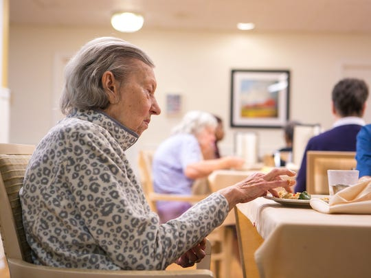 A resident has lunch at Rockland Place where they are serving small plate sized portions to residents suffering from dementia. Experts have found that serving finger foods is a more effective way to get people with dementia to eat.