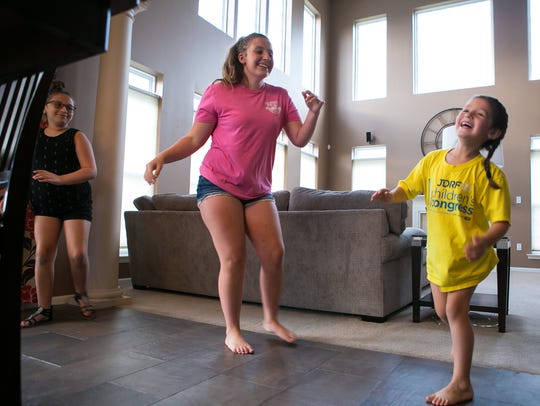 Brynn Palmer (right), 6, dances around with her sisters