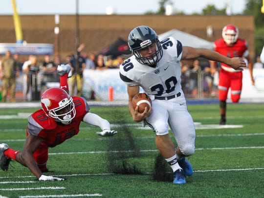West Clermont High School's Austin Maham takes the ball down the field during the WCHS vs Princeton game at West Clermont High School on Friday August 25, 2017. WCHS won the game with a final score of 28-13.