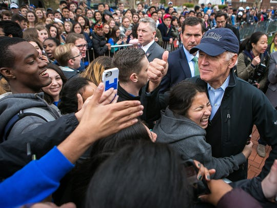 A University of Delaware student hugs former Vice President Joe Biden on The Green at Memorial Hall earlier this year.