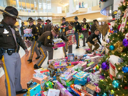 NCCo police deliver toys to children at Nemours Alfred I. duPont Hospital for Children.