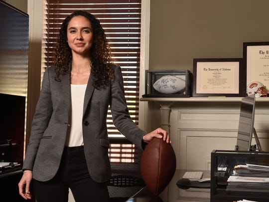 Alexa Stabler, one of 41 NFLPA-certified female sports agents, poses for a photo in her office. She is also the daughter of the late Oakland Raiders Hall of Fame quarterback, Ken Stabler.