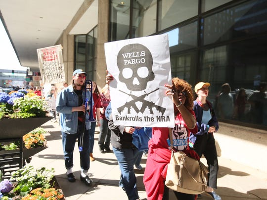 Protesters rally Tuesday, April 24, 2018, outside of