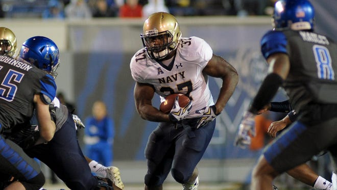 Navy Midshipmen fullback Chris Swain finds running room against Memphis.